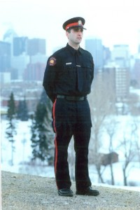 John in uniform with city in background