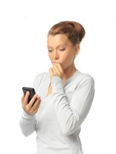 woman looking at phone photo