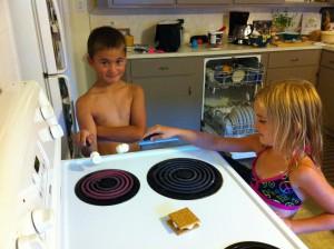 Nicholas and Ella roasting marshmallows