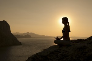 woman meditating on mountain