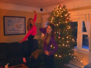 Holly & Taylor posing in front of tree