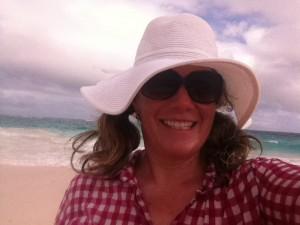 MA selfie in white hat on beach