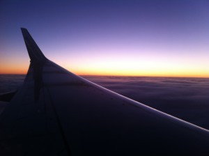plane wing tip and sunset