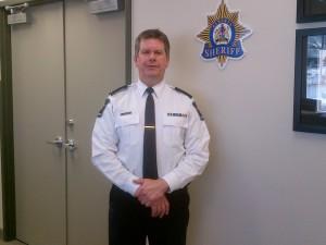Rick in Sheriff's uniform outside office