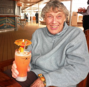 momma-pope-with-tall-fruity-drink-on-deck-300x296