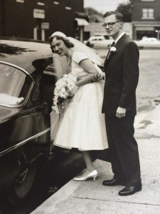 Mom and Dad on wedding day getting into car