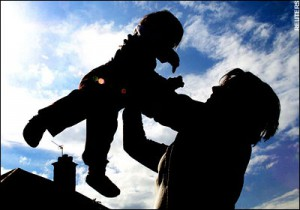 mom holding child in air