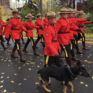 RCMP officers marching with dog