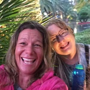 MA & Alison caught in rain under palm tree