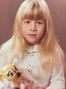 MA as child holding yellow bear