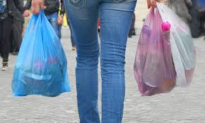 woman carrying plastic bag