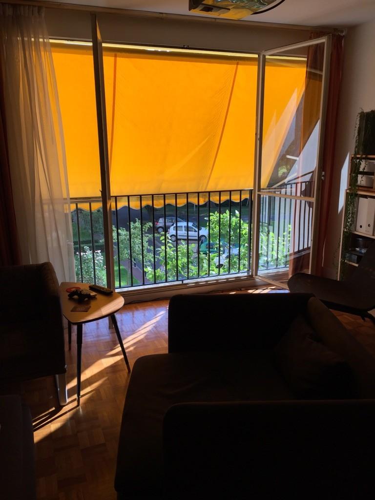 Paris apartment with orange awning