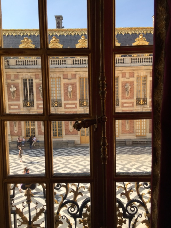 looking-out-window-from-palace-of-versailles